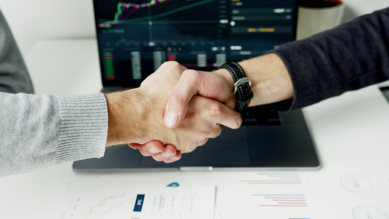 work partners shaking hands