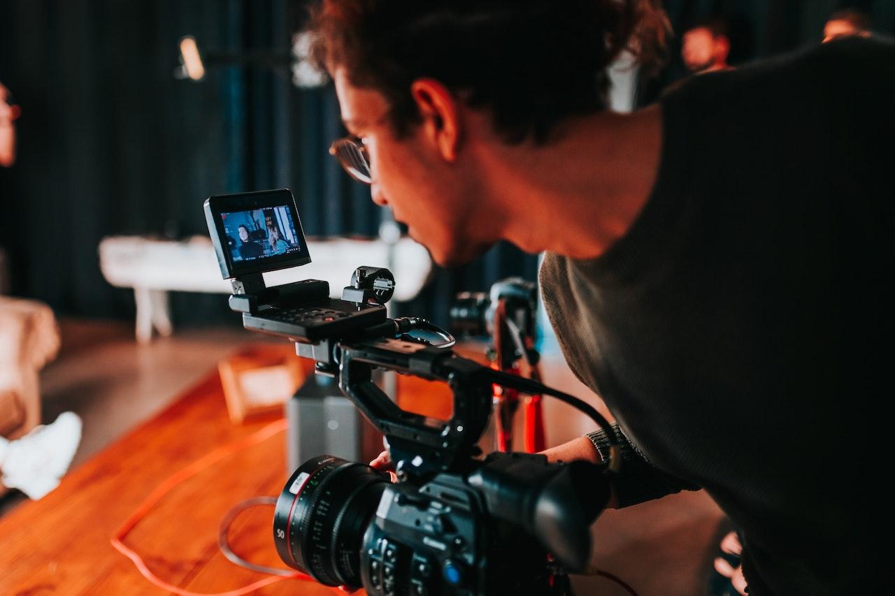 man shooting a video