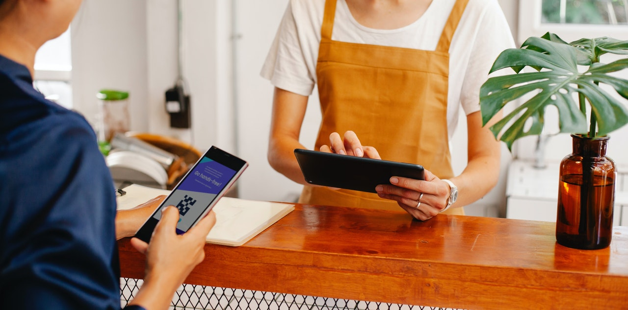 client using digital payment in a shop