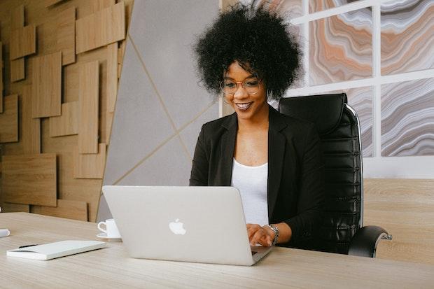 woman smiling at laptop