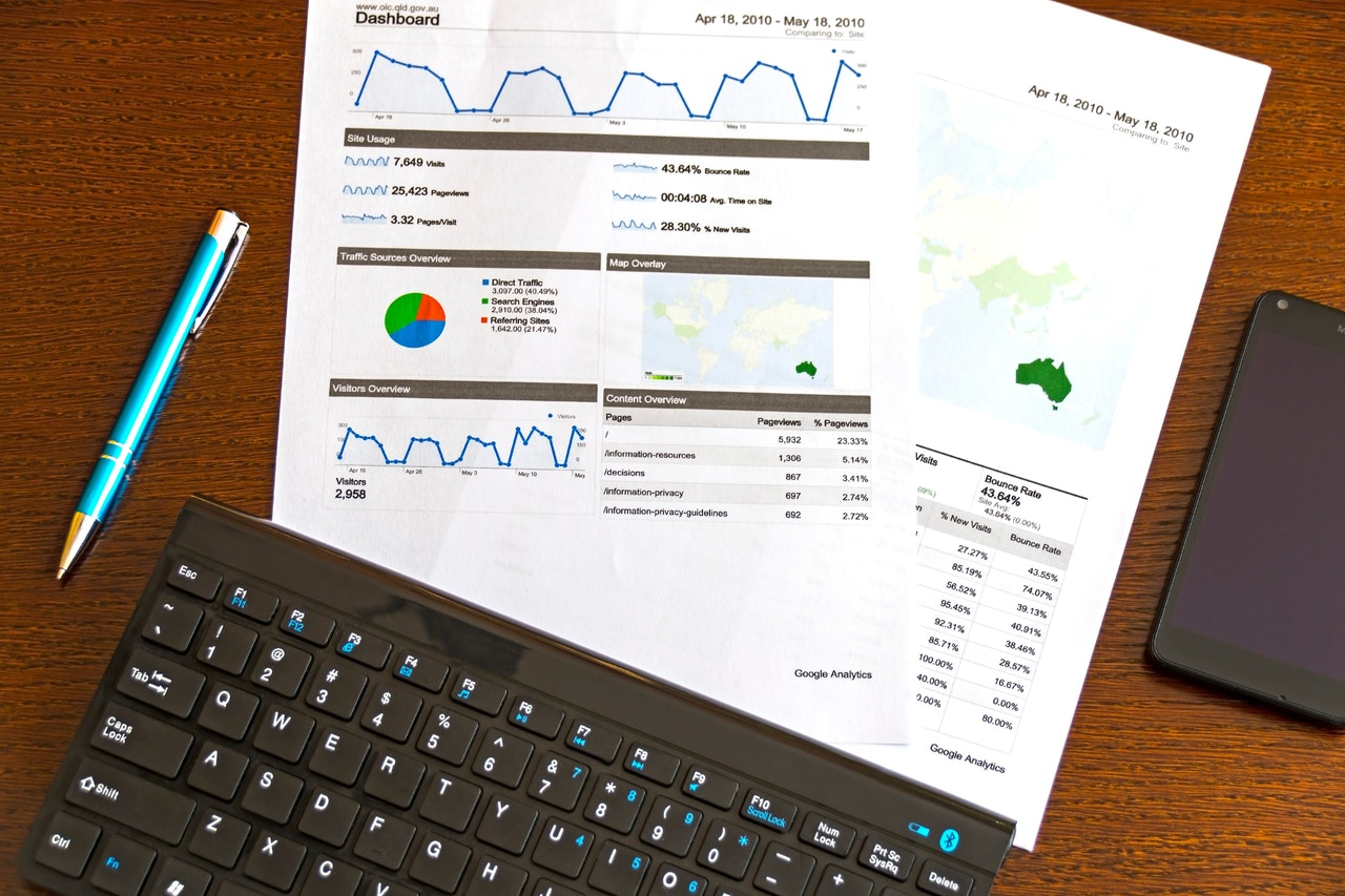 Printed graphs next to a black keyboard