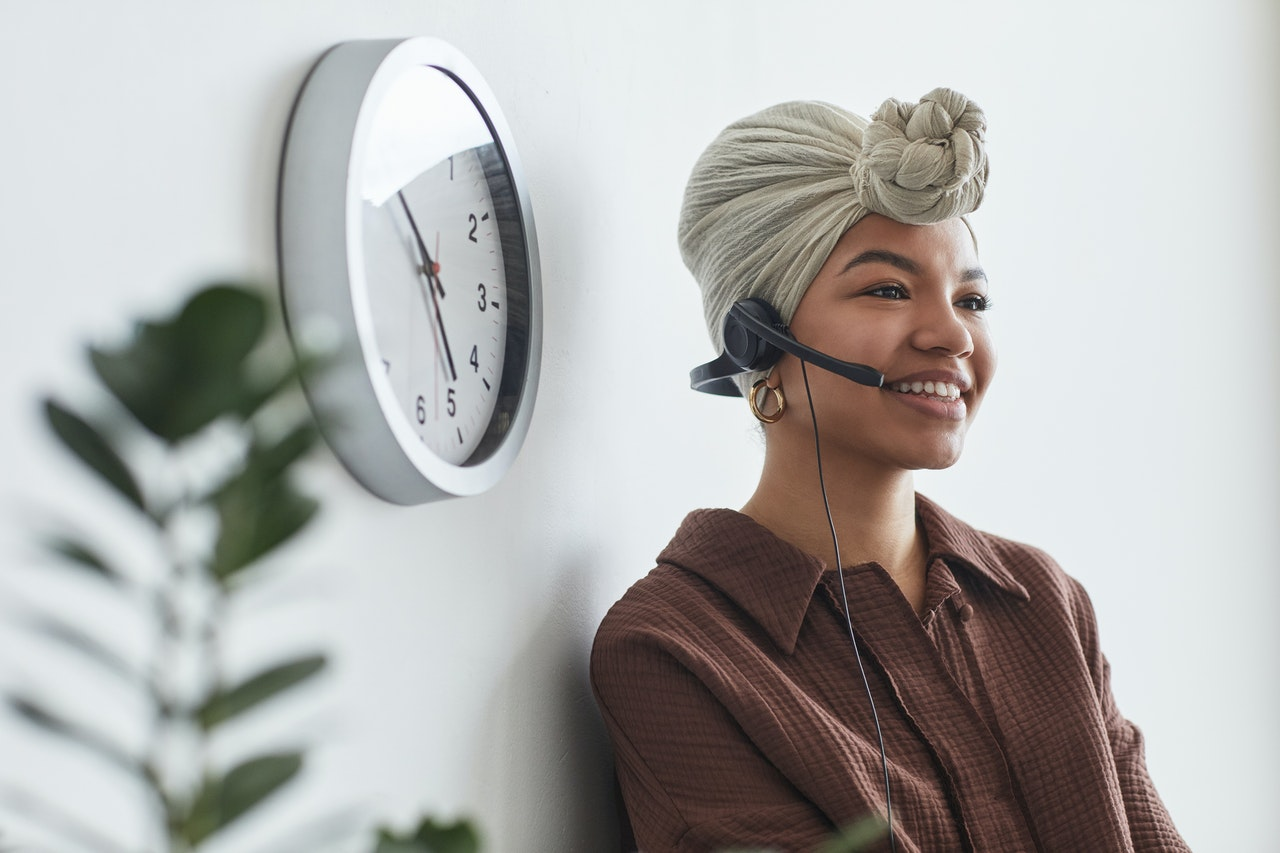 Woman on a conference call with a clock in the background