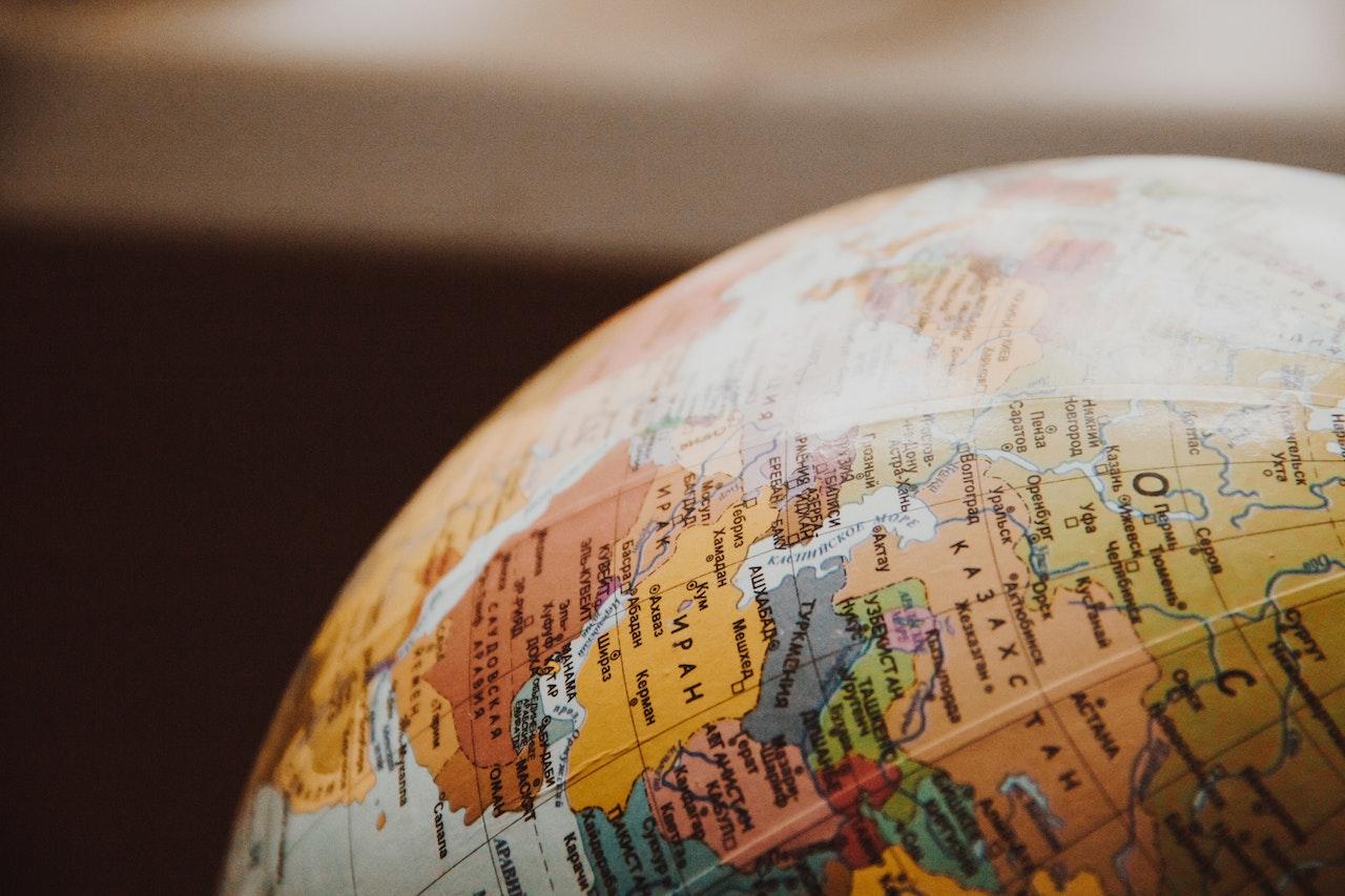 close up of a globe in sepia